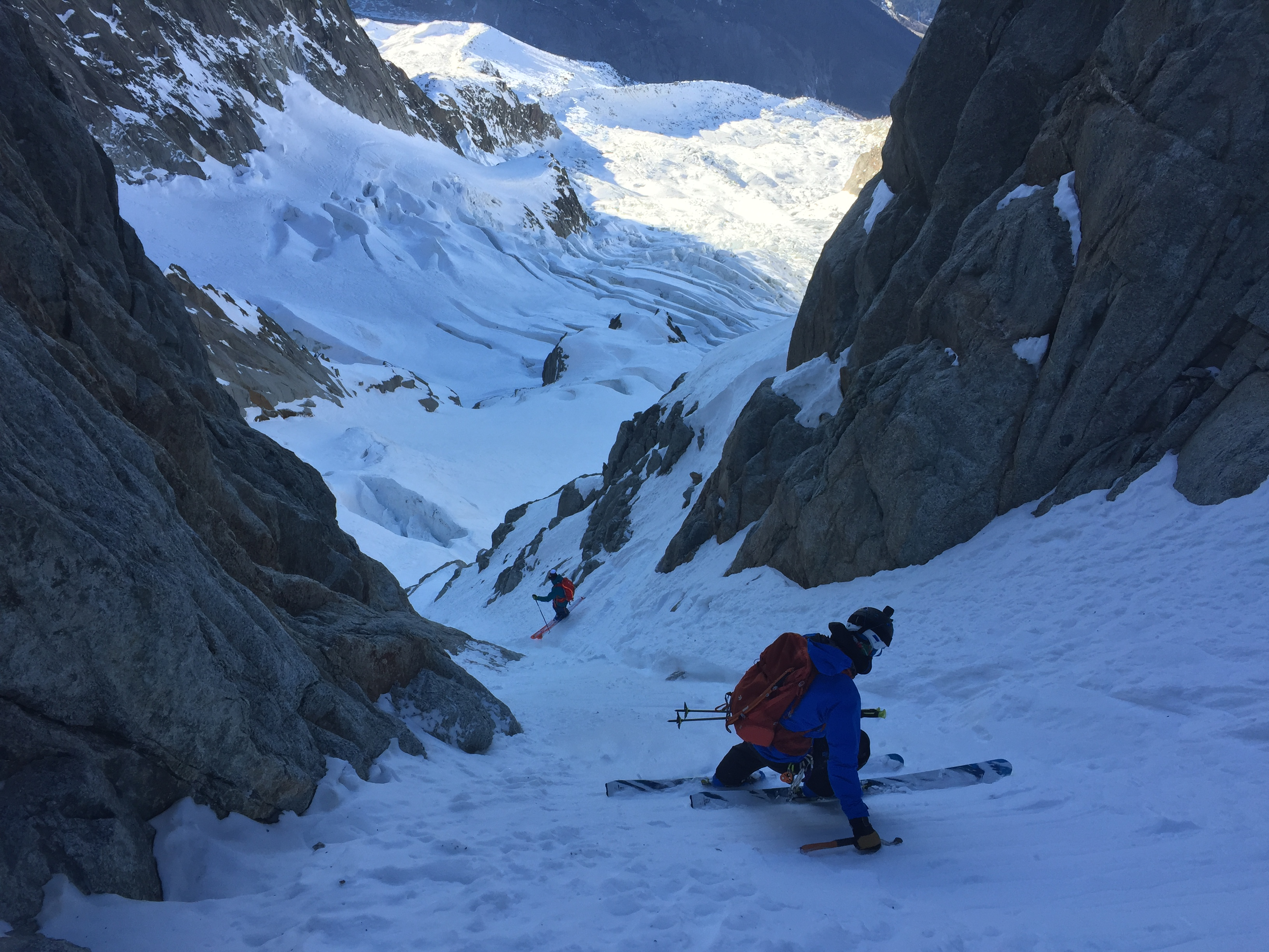 Jesper Petersson and Joel Evans skiing the lower section of the Frigor Couloir. Photo: Pete Houghton