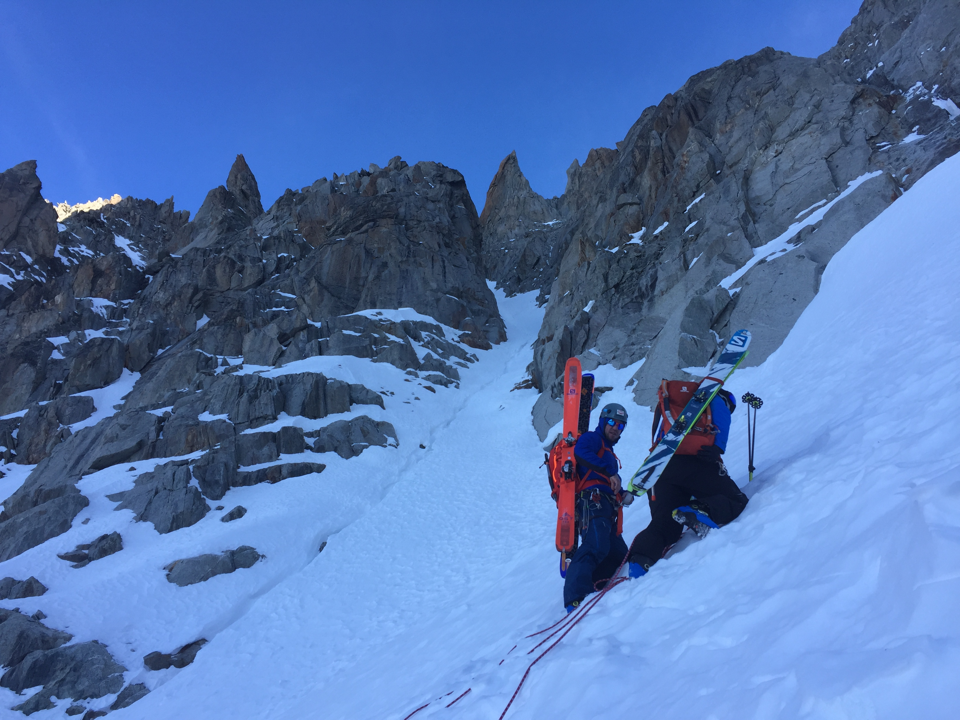 Jesper Petersson and Joel Evans switching to crampons underneath the Frigor Couloir. Photo: Pete Houghton